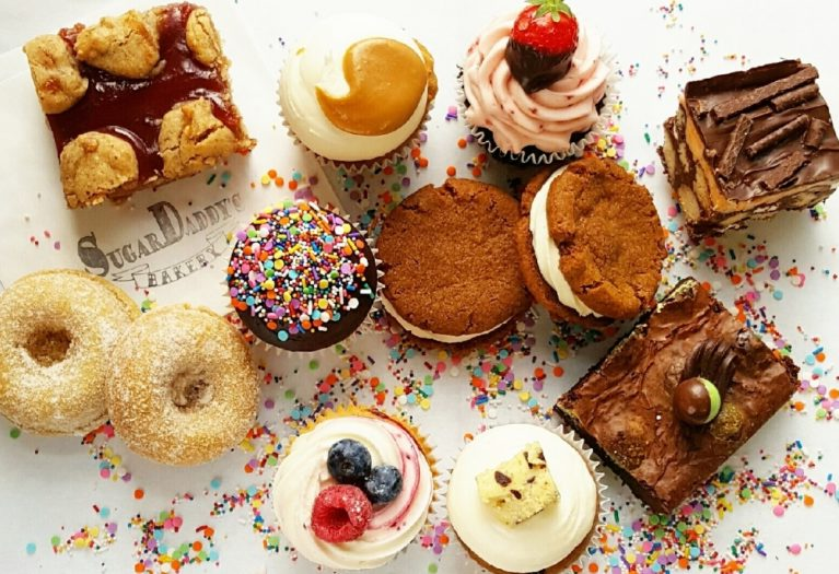 Cakes, donuts and brownies on table with sprinkles, Edinburgh Food and Drink PR