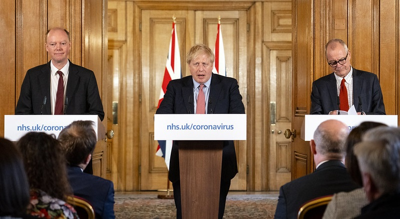 Boris Johnson with political advisers at press conference